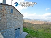 Huge house with a wooden veranda and garage for sale in the Abruzzo region 1