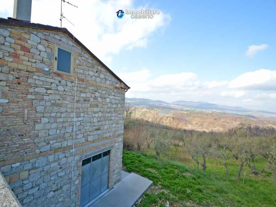 Huge house with a wooden veranda and garage for sale in the Abruzzo region