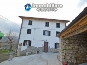 Renovated detached stone house with garden and two garages for sale in Abruzzo 1