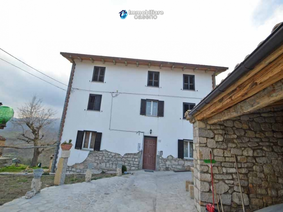 Renovated detached stone house with garden and two garages for sale in Abruzzo