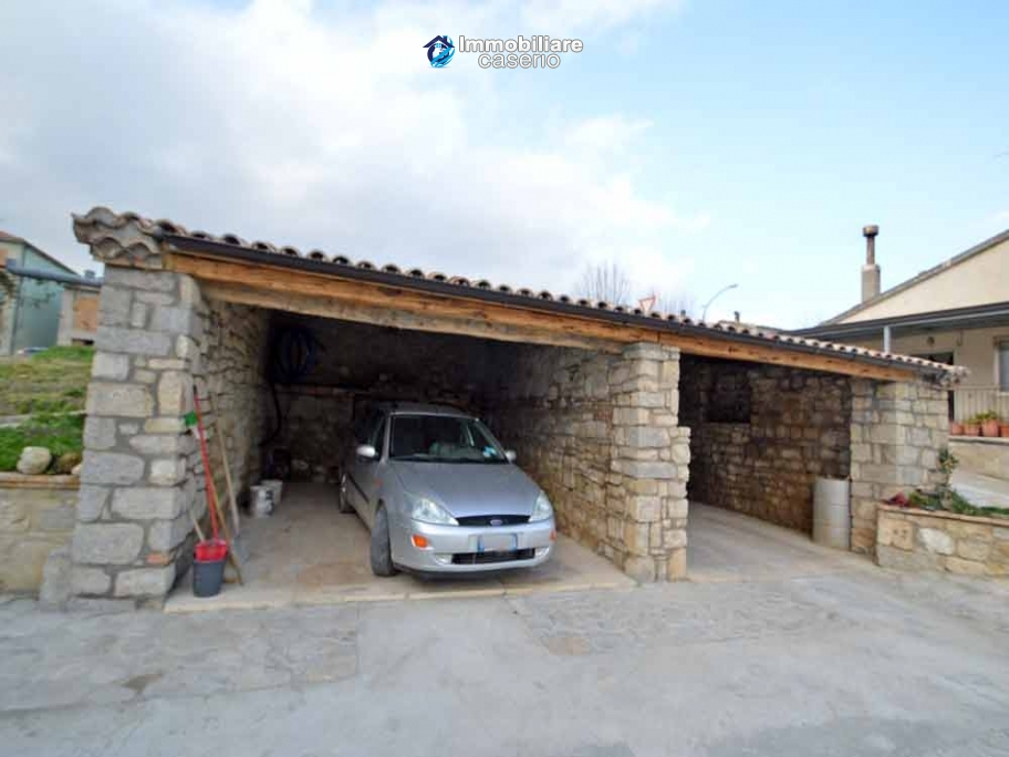 Renovated detached stone house with garden and two garages for Detached garages for sale