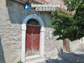 Village house with ancient entrance door and garden for sale in the Abruzzo region 1