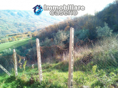 Brick farmhouse surrounded by nature with 11.000 sq m of land for sale in Italy 9