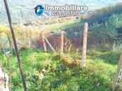 Brick farmhouse surrounded by nature with 11.000 sq m of land for sale in Italy 10