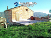 Brick farmhouse surrounded by nature with 11.000 sq m of land for sale in Italy 1