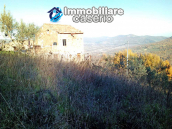 Brick farmhouse surrounded by nature with 11.000 sq m of land for sale in Italy 4