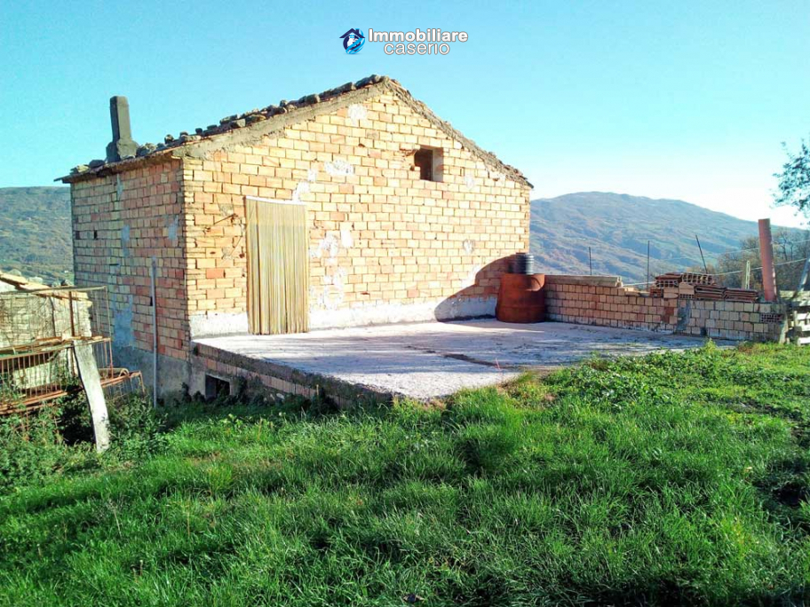 Brick farmhouse surrounded by nature with 11.000 sq m of land for sale in Italy